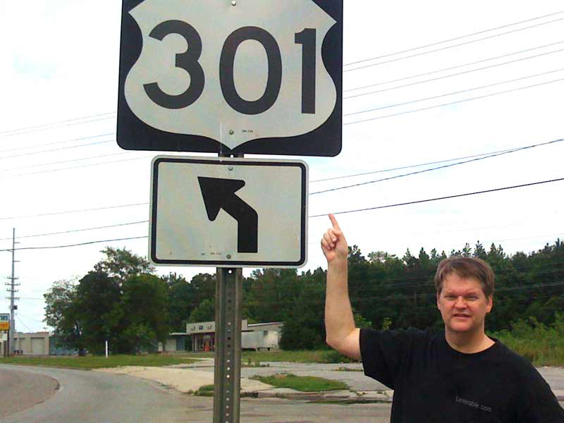 Guy next to 301 redirect sign